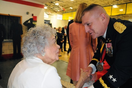 "Maj. Gen. Troy. D. Kok, commanding general for the U.S. Army Reserve's 99th Regional Support Command, greets a veteran May 12 during the 99th RSC's dining out on Joint Base McGuire-Dix-Lakehurst, New Jersey.  The theme of the event was ""Veterans: Then and Now.""  More than 100 veterans from area veteran homes were invited to attend."