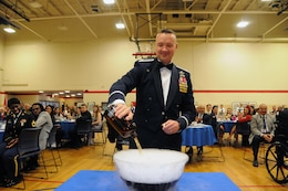 "Col. Frederick Thaden, commander of Joint Base McGuire-Dix-Lakehurst, New Jersey, pours an ingredient into the grog bowl during the U.S. Army Reserve's 99th Regional Support Command dining out May 12 on JBMDL.  The theme of the event was ""Veterans: Then and Now.""  More than 100 veterans from area veteran homes were invited to attend."