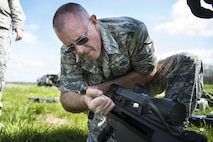 Master Sgt. Chet Nance, 434th Security Forces Squadron non-commissioned officer in charge of Combat Arms, checks the chamber of an M107A1 anti-materiel rifle before clearing it for use at Camp Atterbury-Muskatatuk, Ind., April 19, 2017. Grissom Airmen met at the Southern Indiana Army camp to complete their pre-deployment qualifications on multiple weapons systems during a week-long training operation. (U.S. Air Force Photo/Senior Airman Harrison Withrow)