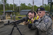 Jerry Skiles, 434th Air Refueling Wing weapon safety manager, and Master Sgt. Chet Nance, 434th Security Forces Squadron non-commissioned officer in charge of Combat Arms, inspect an M240 machine gun at Camp Atterbury-Muskatatuk, Ind., April 21, 2017. Grissom Airmen met at the Southern Indiana Army camp to complete their pre-deployment qualifications on multiple weapons systems during a week-long training operation. (U.S. Air Force Photo/Senior Airman Harrison Withrow)