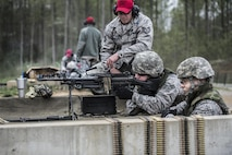 Staff Sgt. Daniel Wallace, 434th Security Forces Squadron Combat Arms instructor, supervises two 434th SFS Airmen qualifying with the M249 squad automatic weapon at Camp Atterbury-Muskatatuk, Ind., April 21, 2017. Grissom Airmen met at the Southern Indiana Army camp to complete their pre-deployment qualifications on multiple weapons systems during a week-long training operation. (U.S. Air Force Photo/Senior Airman Harrison Withrow)