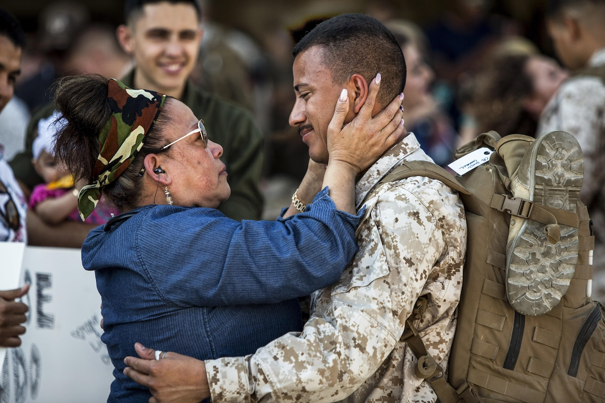 A Marine holds a family member after returning from a deployment.