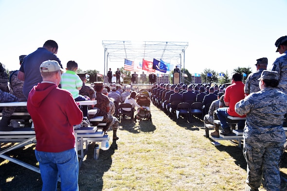 Guests and graduates watch the Community College of the Air Force graduation at the parade field on Goodfellow Air Force Base, Texas, May 12, 2017. The Top 3 hosted the event to recognize individuals who completed the Air Force's equivalent to a two-year degree program. (U.S. Air Force photo by Staff Sgt. Joshua Edwards/Released)