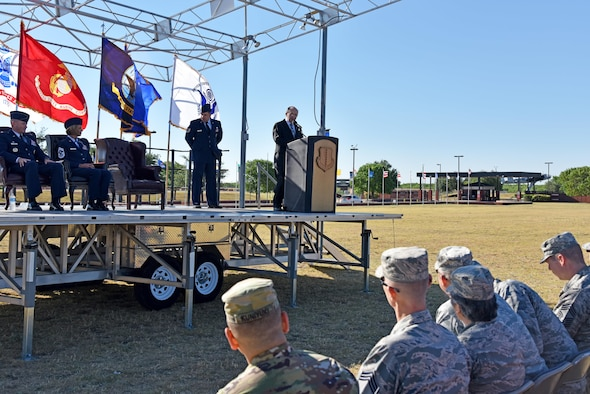 U.S. Air Force Retired Chief Master Sgt. Ed Bendinelli, Community College of the Air Force graduation guest speaker, speaks at the CCAF graduation at the parade field on Goodfellow Air Force Base, Texas, May 12, 2017. Bendinelli spoke about how an education can open possibilities. (U.S. Air Force photo by Staff Sgt. Joshua Edwards/Released)