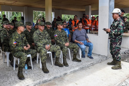 Philippine Army general officers and the Mayor of Calayan receive a brief during a simulated mass casualty scenario in support of Balikatan 2017 on the island of Calayan May 16, 2017. By training together the Philippine and U.S. military build upon shared tactics, techniques, and procedures that enhance readiness and response capabilities to natural disasters. Balikatan is an annual U.S.-Philippine bilateral military exercise focused on a variety of missions, including humanitarian assistance and disaster relief, counterterrorism, and other combined military operations.