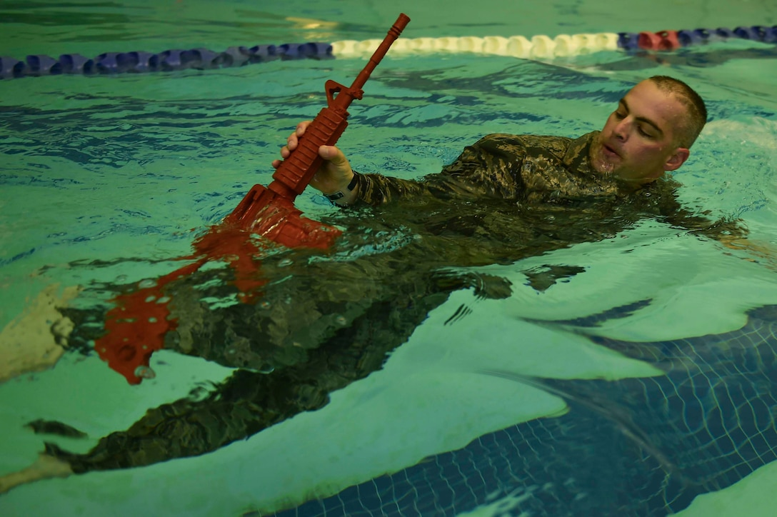 U.S. Air Force Tech. Sgt. George Daggett, 633rd Security Forces Squadron swing shift flight chief, performs a recovery swim during a training evolution at Joint Base Langley-Eustis, Va., April 28, 2017. The 633rd SFS Emergency Services Team conducted a test trial for a course future candidates will have to accomplish in order to join the EST ranks. (U.S. Air Force photo/Senior Airman Derek Seifert)
