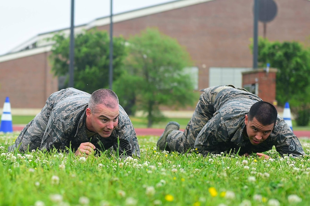 Members of the 633rd Security Forces Squadron Emergency Services Team perform a high crawl during a modified Marine Combat Physical Test at Joint Base Langley-Eustis, Va., April 28, 2017. The team provide services equal to a civilian police SWAT (Special Weapons and tactics) Team , to the installation and train to handle hostage and barricaded suspect situations. (U.S. Air Force photo/Senior Airman Derek Seifert)