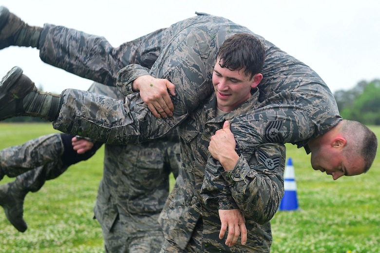 U.S. Air Force Staff Sgt. Gary Good, 633rd Security Forces Squadron unit trainer, performs a buddy carry during a modified Marine Combat Fitness Test at Joint Base Langley-Eustis, Va., April 28, 2017. During the modified Marine Combat Physical Test, Good and his fellow members of the 633rd SFS Emergency Services Team performed a low crawl, high crawl and a fireman carry. (U.S. Air Force photo/Senior Airman Derek Seifert)