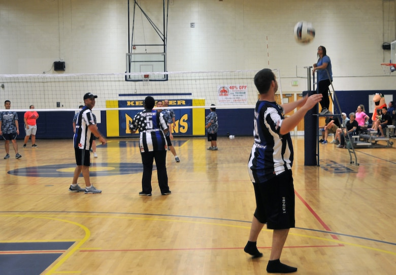A Special Olympics athlete on the 'Badges' team serves the ball during the Boots vs. Badges volleyball game at the Blake Fitness Center, May 13, 2017, on Keesler Air Force Base, Miss. Keesler Airmen competed against City of Biloxi police officers and firefighters as the starting event for the 2017 Special Olympics Mississippi Summer Games, which will be hosted on base for the 31st year May 19-21. (U.S. Air Force photo by 2nd Lt. Teddy Barbosa)