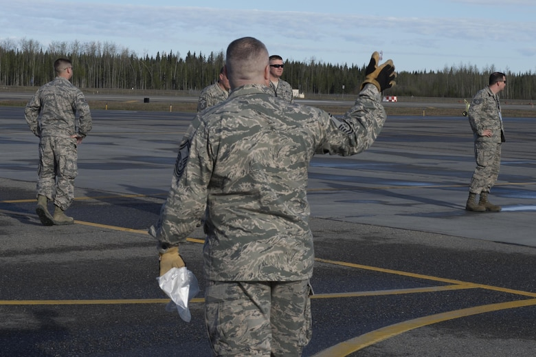 A U.S. Air Force senior master sergeant directs Airmen to line up for a foreign object debris (FOD) walk, May 15, 2017, at Eielson Air Force Base, Alaska. A spring FOD walk is held yearly to ensure Eielson's flightline is prepared for the upcoming RED FLAG-Alaska season. (U.S. Air Force photo by Airman Eric M. Fisher)