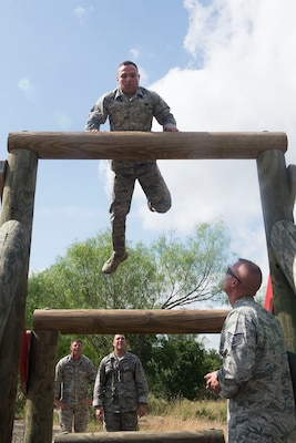 Members of the 802nd and 902 Security Forces Squadrons compete in the Obstacle Course Team Challenge May 15, 2017, at Joint Base San Antonio-Lackland, Texas Medina Annex. The event was held as part of National Police Week, an annual celebration to honor the service and sacrifice of law enforcement members and pays special tribute to law enforcement officers who have lost their lives in the line of duty for the safety and protection of others. JBSA security forces members participated participate in events weeklong May 15-19 across the installations. (U.S. Air Force photo by Staff Sgt. Marissa Garner)