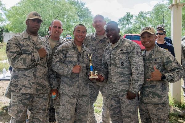 Members of the 343rd Training Squadron accept their second place trophy after competing in the Obstacle Course Team Challenge May 15, 2017, at Joint Base San Antonio-Lackland, Texas, Medina Annex. The event was held as part of National Police Week, an annual celebration to honor the service and sacrifice of law enforcement members and pays special tribute to law enforcement officers who have lost their lives in the line of duty for the safety and protection of others. JBSA security forces members participated participate in events weeklong May 15-19 across the installations. (U.S. Air Force photo by Staff Sgt. Marissa Garner)