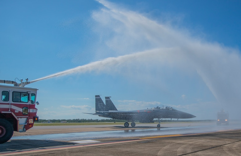 Fire engines from the 96th Civil Engineer Group flank Brig. Gen. Christopher Azzano's F-15 Eagle while they hose down the aircraft during his fini flight at Eglin Air Force Base, Fla. May 15. The fini flight is a symbol of a member's final flight with the unit or base. Azzano's new assignment will take him to Wright-Patterson Air Force Base in Ohio to take command of the Directorate of Air, Space and Cyberspace Operations. (U.S. Air Force photo/Ilka Cole)