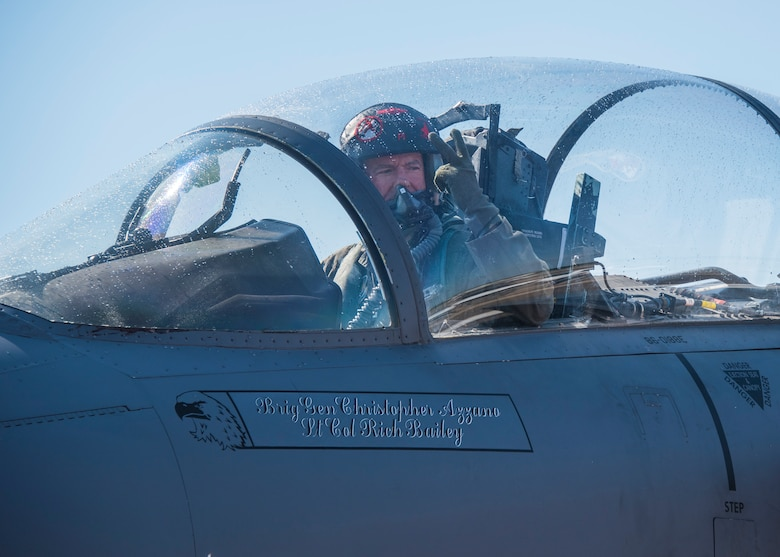 Brig. Gen. Christopher Azzano, 96thTest Wing commander, signals aircraft maintainers during his fini flight at Eglin Air Force Base, Fla. May 15. The fini flight is a symbol of a member's final flight with the unit or base. Azzano's new assignment will take him to Wright-Patterson Air Force Base in Ohio to take command of the Directorate of Air, Space and Cyberspace Operations. (U.S. Air Force photo/Ilka Cole)