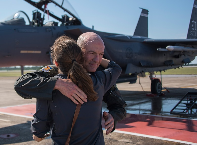 Brig. Gen. Christopher Azzano, 96th Test Wing commander, hugs his daughter, Ali, during his fini flight at Eglin Air Force Base, Fla. May 15. The fini flight is a symbol of a member's final flight with the unit or base. Azzano's new assignment will take him to Wright-Patterson Air Force Base in Ohio to take command of the Directorate of Air, Space and Cyberspace Operations. (U.S. Air Force photo/Ilka Cole)