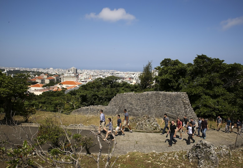 Marines with the 31st Marine Expeditionary Unit hike through Hacksaw Ridge, Okinawa, Japan, May 4, 2017. The Marines, non-commissioned officers with the MEU, visited World War II battle sites throughout Okinawa as part of a Marine Corps Community Services tour that was intended to boost morale throughout the NCO corps of the 31st MEU and sharpen the Marines' mental readiness. As the Marine Corps' only continuously forward deployed unit, the 31st Marine Expeditionary Unit's air-ground-logistics team provides a flexible force, ready to perform a wide range of military operations, from limited combat to humanitarian assistance operations, throughout the Asia-Pacific region. (U.S. Marine Corps photo by Sgt. Tiffany Edwards)