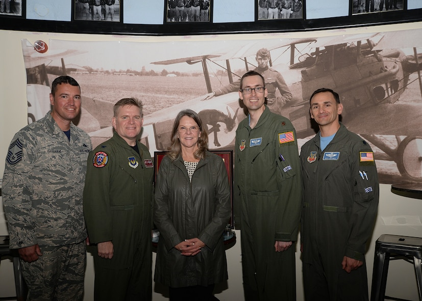 """From left to right, U.S. Air Force Chief Master Sgt. Ronald Garbarini, 100th Aircraft Maintenance Squadron superintendent (formerly 95th Reconnaissance Squadron quality assurance superintendent); U.S. Air Force Col. Thomas Torkelson, 100th Air Refueling Wing commander; Jonna Doolittle Hoppes; Maj. Cary McCreary, 95th RS historian and assistant director of operations, and Lt. Col. Matt Cottrill, 95th RS director of operations, pose for a photo May 12, 2017, at the 95th RS Heritage Hub on RAF Mildenhall, England. Doolittle Hoppes is the granddaughter of Gen. James Harold """"Jimmy"""" Doolittle, American aviation pioneer and retired lieutenant general in the U.S. Army Air Corps. On April 18, 1942, then-Lt. Col. Doolittle led the daylight air raid on Tokyo after the Japanese attacked Pearl Harbor. His crew on that mission became known as the """"Doolittle Raiders."""" During World War II, six of the 16 Doolittle Raiders' crew were from the 95th Bomb Squadron. The 95th BS was redesignated the 95th RS in 1982. (U.S. Air Force photo by Karen Abeyasekere)"""