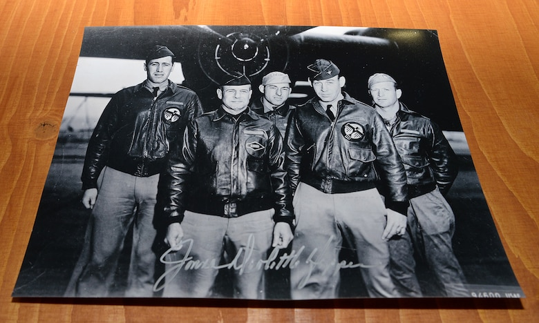 "A photo of Gen. James Harold ""Jimmy"" Doolittle, American aviation pioneer and retired lieutenant general in the U.S. Army Air Corps, and his crew who formed part of the ""Doolittle Raiders,"" sits on a table at the 95th Reconnaissance Squadron Heritage Hub after being signed by Jonna Doolittle Hoppes, Doolittle's granddaughter, May 12, 2017, on RAF Mildenhall, England. While at RAF Mildenhall, Doolittle Hoppes shared that when Spencer Tracy was asked to play the role of her grandfather in the movie ""Thirty Seconds over Tokyo,"" the first thing he said was ""I'll let you know…"" then proceeded to call Jimmy Doolittle himself to ask his permission to play the role. (U.S. Air Force photo by Karen Abeyasekere)"