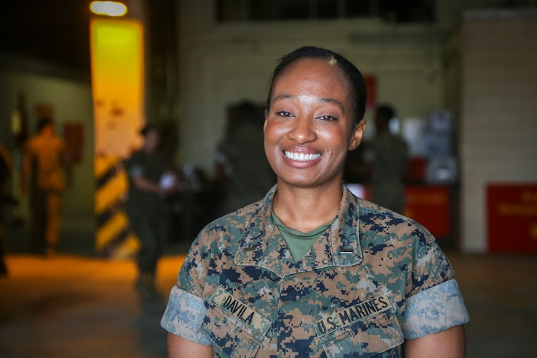 """U.S. Marine Corps 1st Lt. Raquel R. Davila receives the Earle Hattaway Marine Aviation Ground Officer of the Year Award at Marine Corps Air Station Futenma, Okinawa, Japan, April 21, 2017. The Marine Corps Aviation Association awarded Davila for working well to provide aircrafts with parts they needed in order to complete their mission. """"I am very much humbled about someone watching my work and thinking that it's great and I'm appreciative of all the opportunities that were given to me,"""" said Davila. Davila, a native of Brooklyn, New York, is a Supply Response Division officer in charge of the Marine Aviation Logistics Squadron 36, Marine Aircraft Group 36, 1st Marine Aircraft Wing, III Marine Expeditionary Force."""