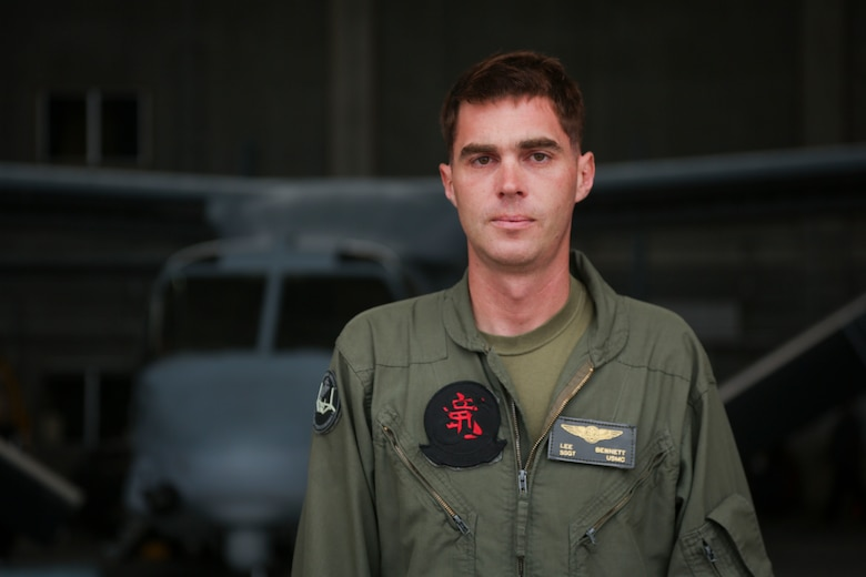 """U.S. Marine Corps Staff Sgt. Lee Bennett receives the Paul G. Vess Avionics Marine of the Year award at Marine Corps Air Station Futenma, Okinawa, Japan, April 21, 2017. The Marine Corps Aviation Association awarded Bennett for his work in repairing the electrical wiring in the avionic system for the V-22 Osprey. """"I got the award but we've got a pretty good group of guys making this happen,"""" said Bennett. Bennet, a native of Havelock, North Carolina, is a V-22 avionics technician with Marine Medium Tilt Rotor Squadron 265, Marine Aviation Logistics Squadron 36, Marine Aircraft Group 36, 1st Marine Aircraft Wing, III Marine Expeditionary Force."""