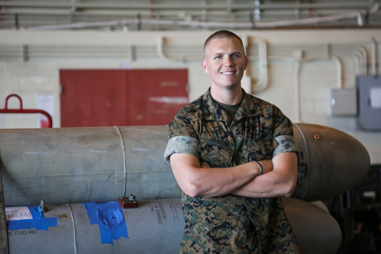 """U.S. Marine Corps Sgt. Justin Tyler Johnson receives the Jack W. Demmond Aviation Ground Marine of the Year award at Marine Corps Air Station Futenma, Okinawa, Japan, April 21, 2017. The Marine Corps Aviation Association awarded Johnson for his efforts in transporting Marines and their gear to and from locations by air, land, and sea. """"I was excited,"""" said Johnson. """"I wasn't really expecting it. I just do my job the best way I can."""" Johnson, a native of Pensacola, Florida, is an embarkation chief with Marine Medium Tilt Rotor Squadron 262, Marine Aircraft Group 36, 1st Marine Aircraft Wing, III Marine Expeditionary Force."""