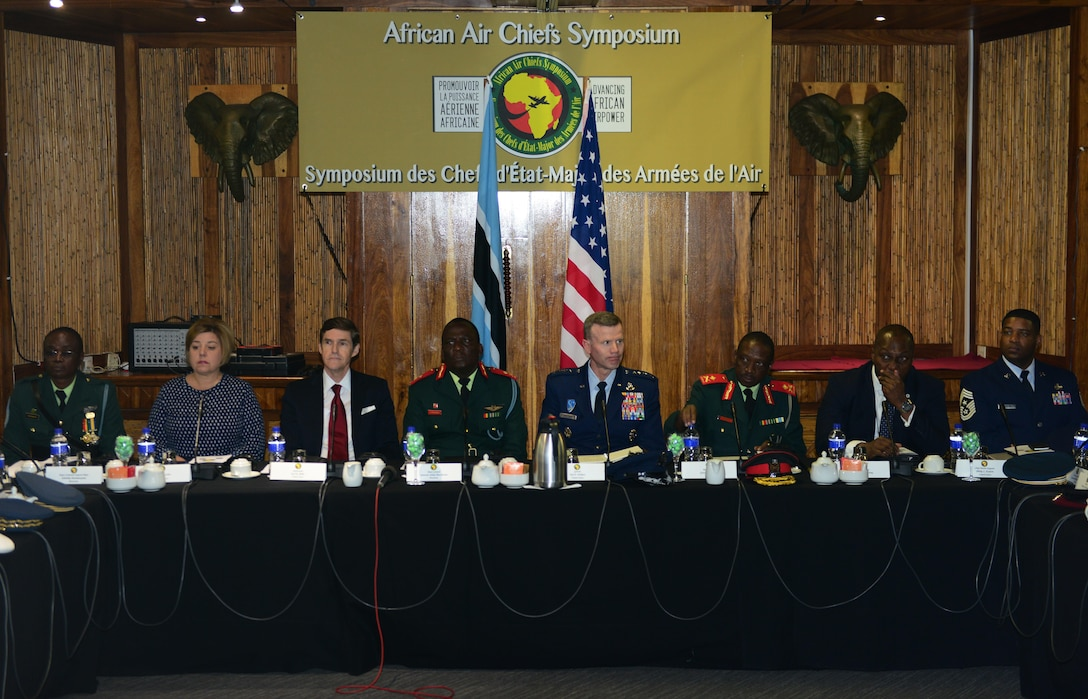 Attendees of the 2017 African Air Chiefs Symposium listen to air chiefs introductions during the opening ceremony in Kasane, Botswana on May 16, 2017. The purpose of the symposium is to create a forum for air chiefs from across the African continent to come together to address regional and continental issues, enhance relationships and increase cooperation. This year's conference will focus on the training aspect of force development. (U.S. Air Force photo by Staff Sgt. Krystal Ardrey)