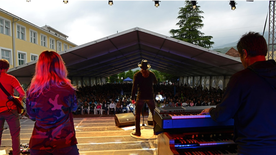 Trace Adkins, Grammy Award–nominated country music singer, performs for a crowd of Airmen and their families at Aviano Air Base, Italy, May 12, 2017.  The performance is part of his 12th USO tour. (Photo by U.S. Air Force Airman 1st Class Ryan Brooks)