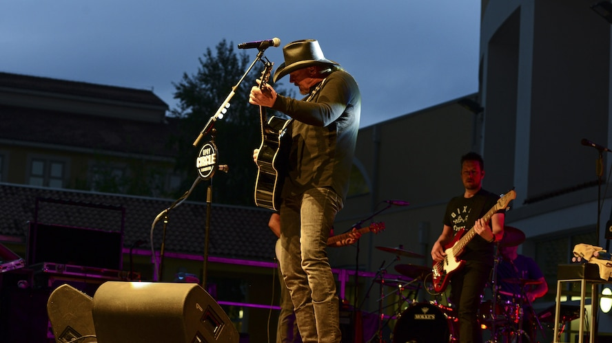 Trace Adkins, country music entertainer, plays his guitar during a concert at Aviano Air Base, Italy, May 12, 2017. This is part of Adkins' Spain and Italy USO tour. (Photo by U.S. Air Force Airman 1st Class Ryan Brooks)