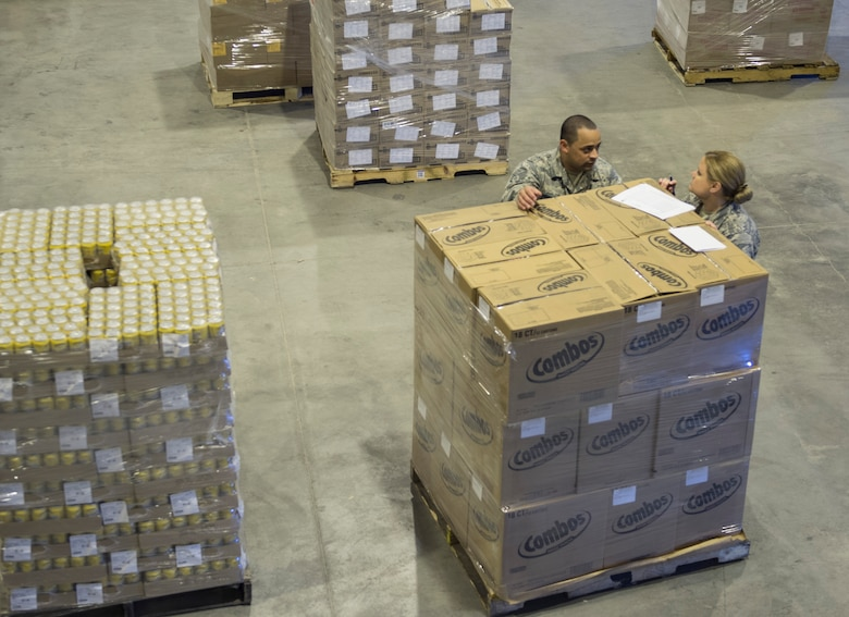 U.S. Air Force Tech. Sgt. Holli Woods, right, and Staff Sgt. Saul Garcia Qinones both with the 379th Expeditionary Force Support Squadron compare the shipping manifest to the order received at Al Udeid Air Base, Qatar May 10, 2017. Each week, a small team of Airmen work together to review shipments of produce, making sure the numbers matches the quantity received and that the quality of the produce meets standards. (U.S. Air Force photo by Tech. Sgt. Amy M. Lovgren)