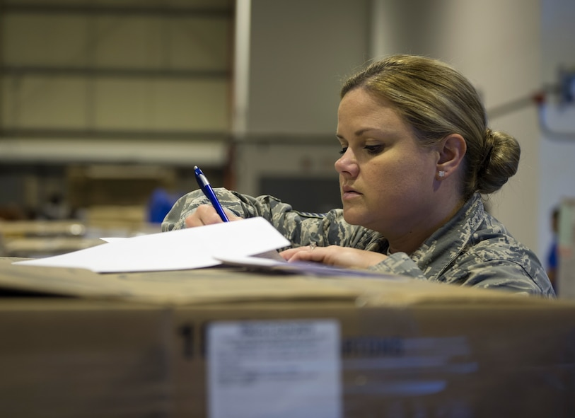 U.S. Air Force Tech. Sgt. Holli Woods, section chief with the 379th Expeditionary Force Support Squadron, checks the shipment manifest numbers against the shipment received at Al Udeid Air Base, Qatar May 10, 2017. Each week, a small team of Airmen work together to review shipments of produce, making sure the numbers matches the quantity received and that the quality of the produce meets standards. (U.S. Air Force photo by Tech. Sgt. Amy M. Lovgren)