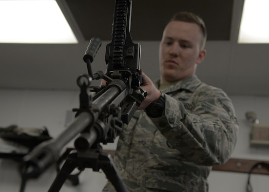 Airman 1st Class John Broda, 5th Security Forces Squadron defender, assembles an M249 light machine gun at the Combat Arms Training and Maintenance facility on Minot Air Force Base, N.D., May 8, 2017. To qualify on the weapon, Broda must properly disassemble and reassemble the M249. (U.S. Air Force photo/Airman 1st Class Dillon Audit)