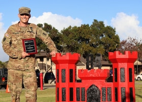 "Army Maj. Andrew ""Drew"" Johannes, from Stillwater, Okla., is a 2017 recipient of the Federal Engineer of the Year Award, an annual award honoring the top engineers employed by federal agencies across the country. He currently serves as the battalion executive officer of the 84th Engineer Battalion, 130th Engineer Brigade, 8th Theater Sustainment Command at Schofield Barracks, Hawaii. He's pictured displaying his award in Hawaii, Feb. 17, 2017. Courtesy photo"