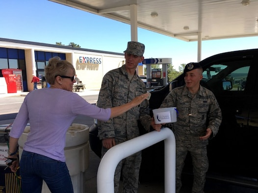 Defenders assigned to 10th Security Forces Squadron collect donations as part of the Air Force Assistance Fund campaign at the U.S. Air Force Academy, Colo., May 12, 2017. Seventeen volunteers from the squadron washed car windshields at the Academy Shopette to solicit donations. The squadron raised more than $3,300 for the AFAF. (Courtesy photo/Chief Master Sgt. Shadd McKee)