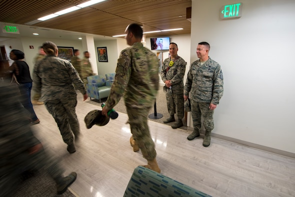 PETERSON AIR FORCE BASE, Colo. – Chief Master Sgt. Brendan Criswell, Air Force Space Command command chief, and Staff Sgt. Derrick Grinnell, 21st Civil Engineer Squadron fire inspector 2, assess the exiting speed of service members in the clinic during a fire drill at Peterson Air Force Base, Colo., May 11, 2017.  Grinnell and Criswell administered fire drills at various locations on base as part of the monthly inspection process. (U.S. Air Force photo by Airman 1st Class Dennis Hoffman)