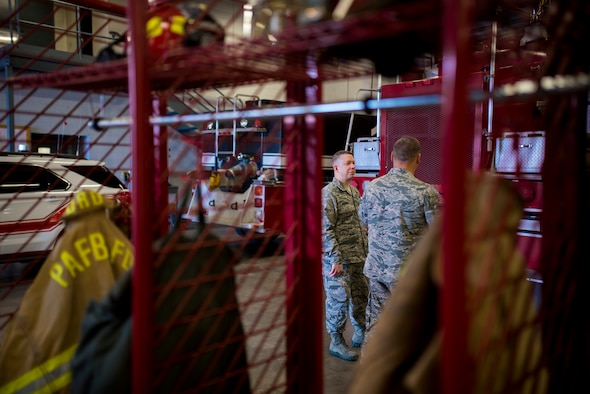 PETERSON AIR FORCE BASE, Colo. – Chief Master Sgt. Brendan Criswell, Air Force Space Command command chief, tours the Fire Station with Staff Sgt. Derrick Grinnell, 21st Civil Engineer Squadron fire inspector 2, at Peterson Air Force Base, Colo., May 11, 2017.  Criswell spent the day shadowing Grinnell on the duties of a fire inspector at Peterson AFB. (U.S. Air Force photo by Airman 1st Class Dennis Hoffman)