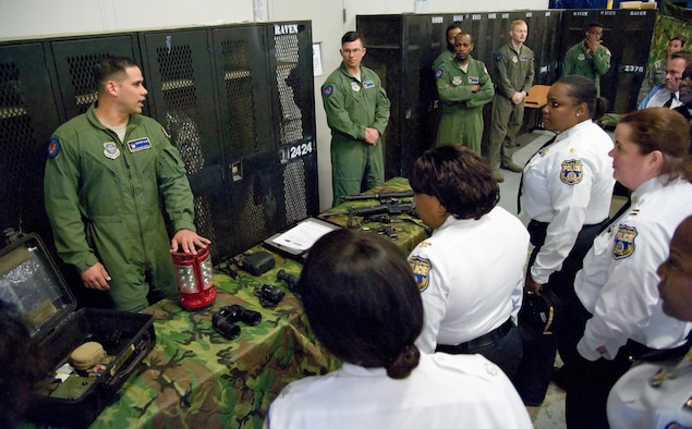 Staff Sgt. Steven Tayfel, a 436th Security Forces Squadron Raven, answers questions from members of the Philadelphia Police Department, Philadelphia, Pa., May 11, 2017, at Dover Air Force Base, Del. Tayfel and other Ravens talked about training requirements and equipment used by Ravens during off-station deployments. (U.S. Air Force photo by Roland Balik)