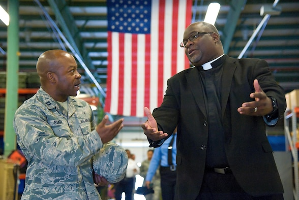 Chaplain (Capt.) Kevin Pugh, 436th Airlift Wing, talks with Reverend Darryl Scott, Philadelphia Police Department Police Clergy, Philadelphia, Pa., while visiting the 436th Security Forces Squadron Ravens section May 11, 2017, at Dover Air Force Base, Del. Fifteen members of the police department toured different sections of the 436th SFS during their five-hour visit to the base. (U.S. Air Force photo by Roland Balik)