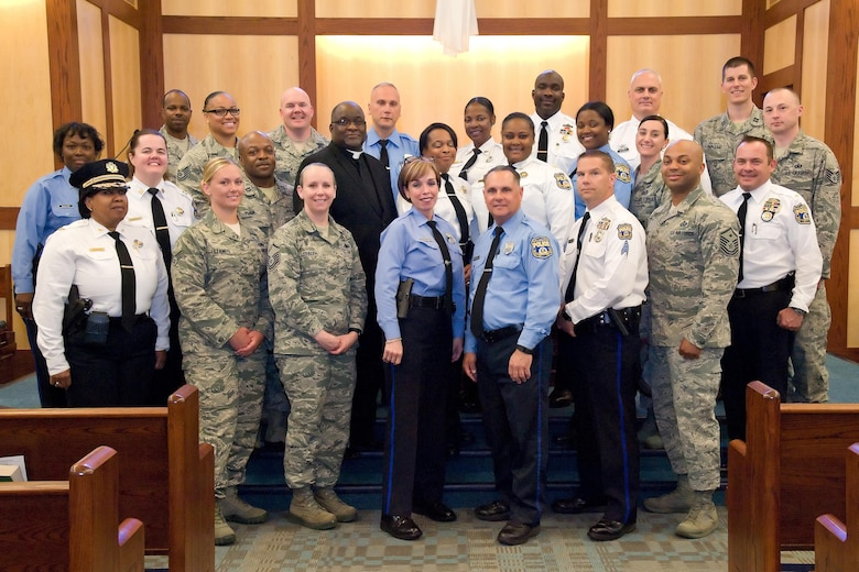 Members of the 436th Security Forces Squadron, Philadelphia Police Department, Philadelphia, Pa., and Base Chapel staff, pose for a group photo May 11, 2017, at Dover Air Force Base, Del. Fifteen members of the police department toured the 436th SFS, Air Force Mortuary Affairs Operations and Base Chapel during their five-hour visit to the base. (U.S. Air Force photo by Roland Balik)