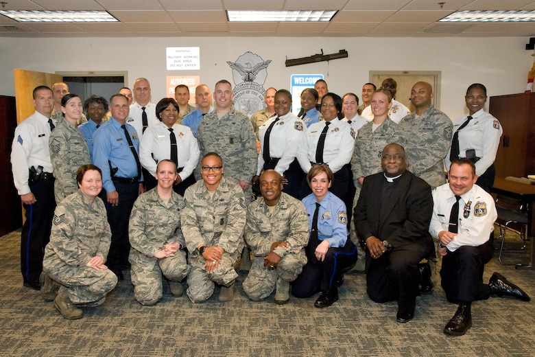 Members of the 436th Security Forces Squadron and Philadelphia Police Department, Philadelphia, Pa., pose for a group photo May 11, 2017, at building 910 on Dover Air Force Base, Del. Fifteen members of the police department received a mission brief, observed both a military working dog and a Raven Redman suit demonstration, a tour of Air Force Mortuary Affairs Operations and the Base Chapel. (U.S. Air Force photo by Roland Balik)