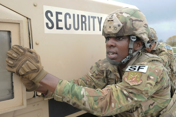 Airman 1st Class Rosa Young, 891st Missile Security Forces Squadron response force member, pushes a Humvee at Minot Air Force Base, N.D., May 1, 2017. The 91st Security Forces Group Global Strike Challenge team trained for the upcoming competition for over a month. (U.S. Air Force photo/Airman 1st Class Jessica Weissman)