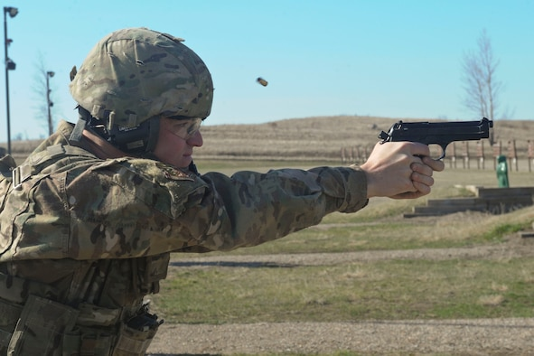 Airman Ryan Benjamin, 91st Missile Security Forces Squadron response force member, fires an M9 pistol at Camp Grafton South, Devil's Lake, N.D., May 4, 2017. The 91st Security Forces Group Global Strike Challenge team trained in preparation for the upcoming competition, which challenges security forces tactics, job knowledge and weapons firing. (U.S. Air Force photo/Airman 1st Class Jessica Weissman)