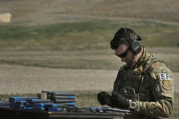Staff Sgt. Kyle Douglass, 91st Security Forces Group physical security NCO in charge, loads a magazine at Camp Grafton South, Devil's Lake, N.D., May 4, 2017. The 91st SFG Global Strike Challenge team trained in preparation for the upcoming competition, which challenges security forces tactics, job knowledge and weapons firing. (U.S. Air Force photo/Airman 1st Class Jessica Weissman)
