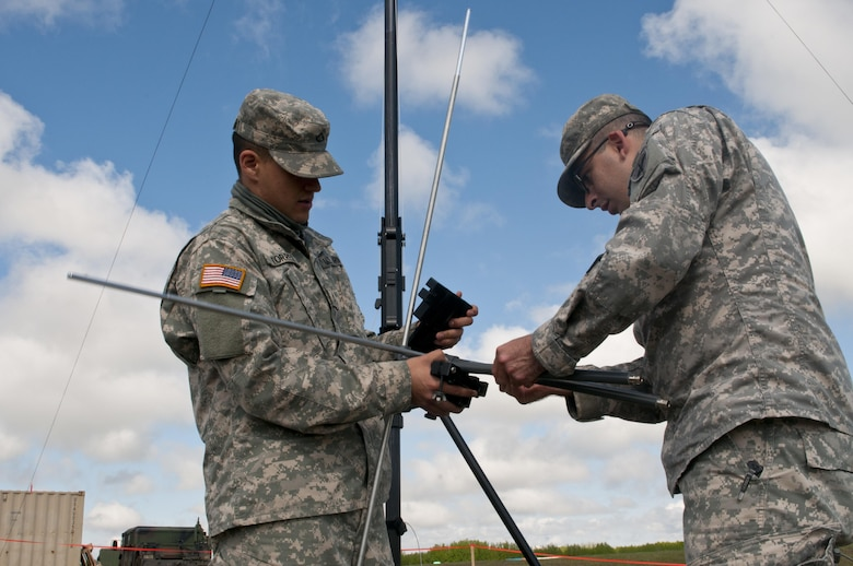 Pfc. Ismael Torres, a cable system installer maintainer, left, and Spc. Cody Gomez, a microwave system operator maintainer, assemble a transmission antenna during Exercise Maple Resolve 17 at Camp Wainwright, Alberta, May 16, 2017. Torres and Gomez, both California natives, belong to the 306th Psychological Operations Company. Exercise Maple Resolve is an annual collective training event designed for any contigency operation. Approximately 4,000 Canadian and 1,000 U.S. troops are participating in Exercise Maple Resolve 17.