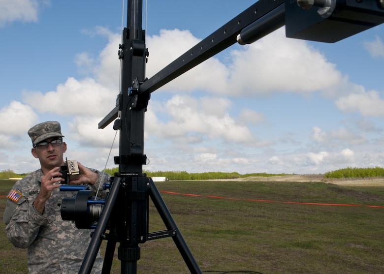 Spc. Cody Gomez, a microwave system operator maintainer for the 306th Psychological Operations Company, assembles a transmission antenna during Exercise Maple Resolve 17 at Camp Wainwright, Alberta, May 16, 2017. Exercise Maple Resolve is an annual collective training event designed for any  contigency operation. Approximately 4,000 Canadian and 1,000 U.S. troops are participating in Exercise Maple Resolve 17.