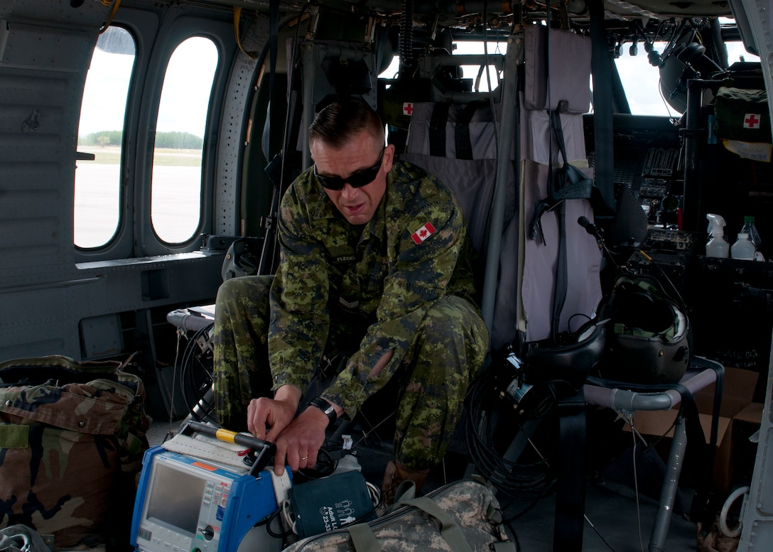 Canadian Cpl. Jason Flegel, a forward aeromedevac specialist with the 2nd Field Ambulance, readies medical equipment and his personal gear aboard a Blackhawk helicopter prior to performing a joint Medevac training mission with members of the 1-169th Aviation Regiment during Exercise Maple Resolve 17 at Camp Wainwright, Alberta, on May 16, 2017. Exercise Maple Resolve is an annual collective training event designed for any contingency operation. Approximately 4,000 Canadian and 1,000 U.S. troops are participating in Exercise Maple Resolve 17.