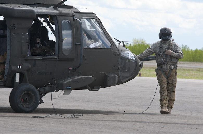 Sgt. Christopher Raynor, a crew chief with the 1-169th Aviation Regiment, prepares to embark on a joint medevac training mission during Exercise Maple Resolve 17 at Camp Wainwright, Alberta, May 16, 2017. Exercise Maple Resolve is an annual collective training event designed for any  contigency operation. Approximately 4,000 Canadian and 1,000 U.S. troops are participating in Exercise Maple Resolve 17.