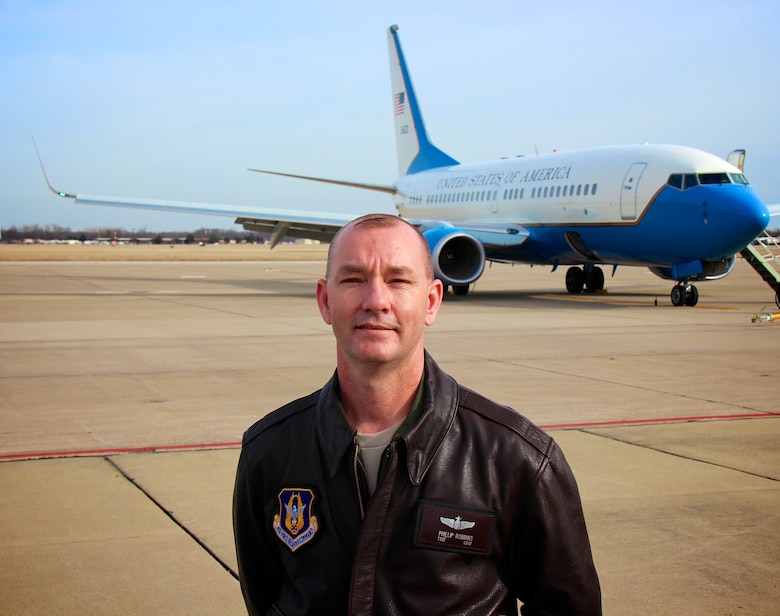 Tech. Sgt. Phillip Robbins, is a flight attendant for the 932nd Airlift Wing, flying the blue, white and gold C-40C aircraft at Scott Air Force Base, Ill.. He helps distinguished visitors with loading their heavy luggage ahead of the trip, and spends many hours ahead of each trip to plan each leg of the journey.  He additionally prepares meals during the flights.  The airplane which is constantly on the go, will be available for a limited time to see during the upcoming Scott Air Force Base Air Show on June 10-11, 2017.  (U.S. Air Force photo by Lt. Col. Stan Paregien)