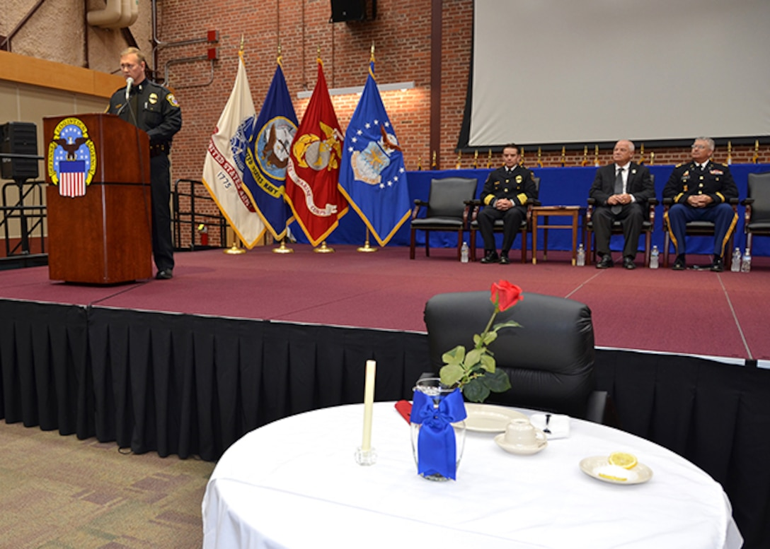 Defense Logistics Agency Installation Support at Richmond Police Officer Sgt. Bradley McCoy highlights the Table of Honor representing officers who died in the line of duty and explained its significance to those gathered for a ceremony honoring fallen law enforcement officers May 11, 2017 in the Frank B. Lotts Conference Center on Defense Supply Center Richmond, Virginia.