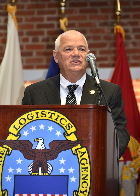 Retired Chesterfield County Sheriff Dennis Proffit speaks to attendees at a ceremony May 11, 2017 honoring fallen law enforcement officers in the Frank B. Lotts Conference Center on Defense Supply Center Richmond, Virginia.