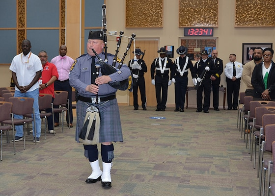 "Virginia State Police Trooper Sgt. Mike McCann performs ""Amazing Grace"" on bagpipes during a ceremony May 11, 2017 honoring fallen law enforcement officers in the Frank B. Lotts Conference Center on Defense Supply Center Richmond, Virginia."